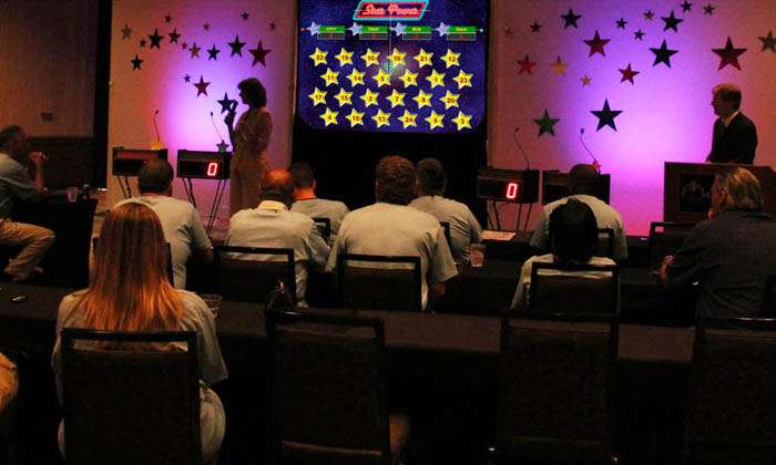 Star Power with up-light backdrop at company event